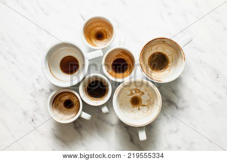 Top view empty and dirty cups of coffee, afterparty concept