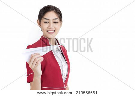 Portrait Of Attractive Asian Air Hostess Holdong Paper Airplane With White Background, Woman Stand A