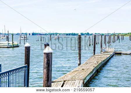 City Island harbor in Bronx New York with boats and pier Manhattan skyline or cityscape in distance