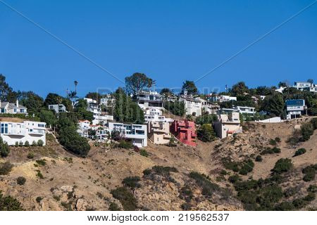 Cluster of pacific view hilltop canyon homes in Malibu, California.