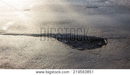 pothole on asphalted road. pothole on asphalt