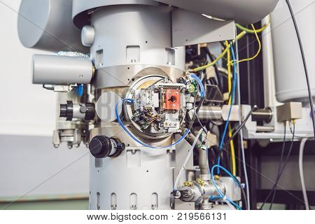 A Sample Preparation Table In A Laboratory With An Optical Microscope, Ultrasonic Cutter System And