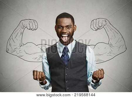 Closeup portrait happy successful student business man winning fists pumped celebrating success isolated grey wall background. Positive human emotion facial expression. Life perception achievement