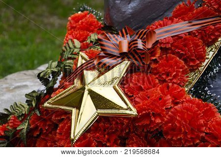 Wreath with a star on the monument. Victory Day. Symbols of the day of victory over fascist Germany