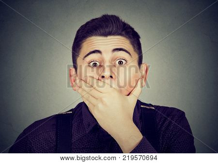 portrait of surprised young man looking at camera
