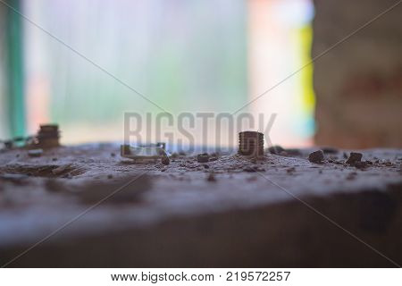 the floor of the abandoned building with dust and scrap