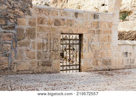 Near Mitzpe Yeriho Israel November 25 2017 : Decorative wicket in the wall at the entrance to the monastery of St. George Hosevit (Mar Jaris) in Wadi Kelt near Mitzpe Yeriho in Israel