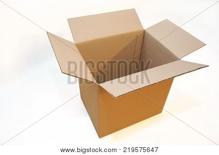 Open box made of cardboard on a white background. Isolated