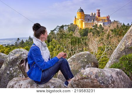 Famous landscape and Palace of Pena, Woman traveler in Sintra, Lisboa