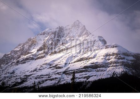 One of the many mountain peaks that line the Icefields Parkway between Lake Louise and Jasper National Park in Alberta, Canada
