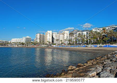 Sand coastline of Marbella town at Costa del Sol, Andalusia, Spain
