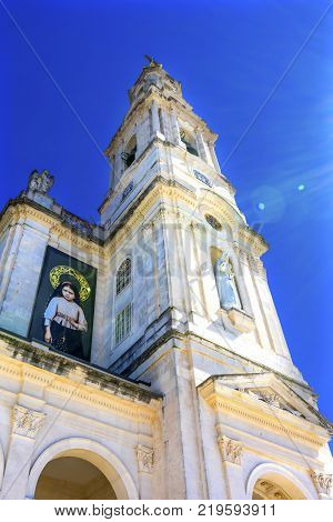 FATIMA, PORTUGAL  - SEPTEMBER 17, 2017 100th Celebration Mary's Appearance Basilica of Lady of Rosary Bell Tower Fatima Portugal. Church created on site where three Portuguese Shepherd children saw Virgin Mary of the Rosary. Basilica created in 1953. Bann
