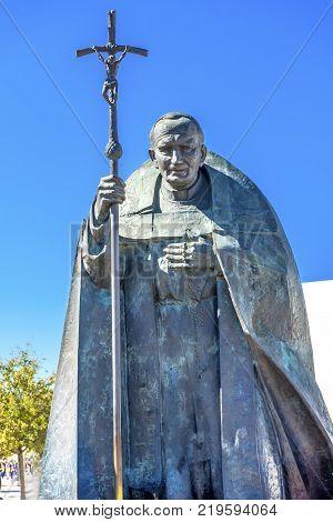 FATIMA, PORTUGAL  - SEPTEMBER 17, 2017 Pope John Paul II Statue Basilica of Lady of Rosary Fatima Portugal. Great pope who believe in Fatima. Statue created in 2008 by Polish Sculptor Czeslaw Dzwigaj.