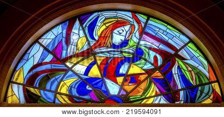 FATIMA, PORTUGAL - SEPTEMBER 17, 2017 Mary Stained Glass Basilica of Lady of Rosary Fatima Portugal. Church created on site where three Portuguese Shepherd children saw Virgin Mary of the Rosary. Basilica created in 1953.