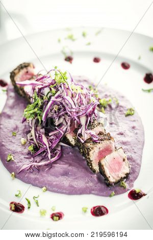 gourmet asian fusion cusine seared tuna and sesame in beetroot sauce meal