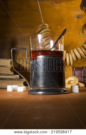 Tea in a glass with a glass holder on the desk