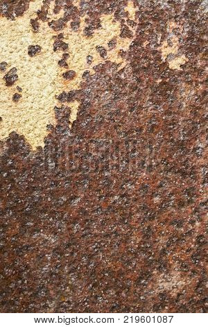 piece of sheet metal with large pieces of rust and discolored paint