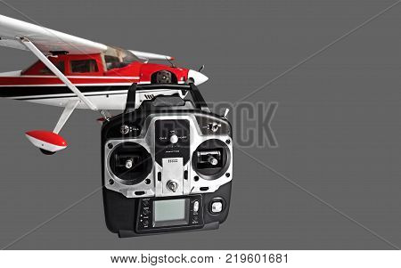 Radio Controlled Airplane with Radio Remote Control Isolated on Gray Background Clipping Path