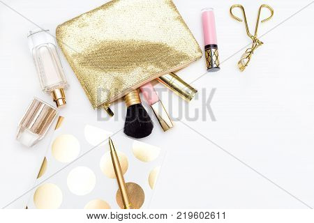 Make-up cosmetics and notebook with pen on white background. Copy space