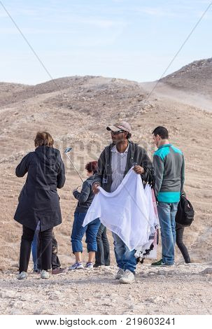 Near Mitzpe Yeriho Israel November 25 2017 : Bedouin - the seller of handmade decorative ornaments and memorable souvenirs on the viewing platform near Mitzpe Yeriho in Israel
