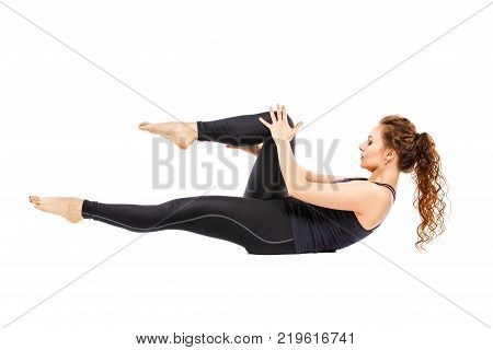 Young fit woman doing pilates excercises isolated on white background