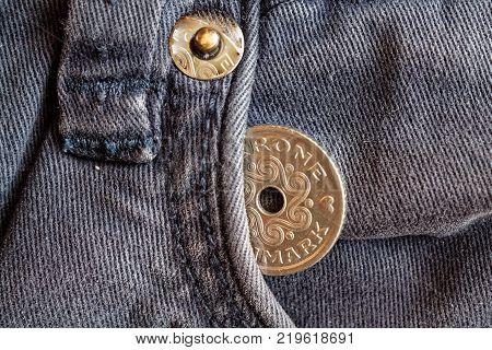 Denmark coin denomination is 1 krone (crown) in the pocket of obsolete blue denim jeans