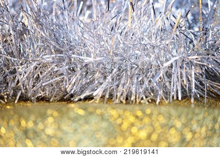 silver tinsel on a gold background for decorating a Christmas festive tree