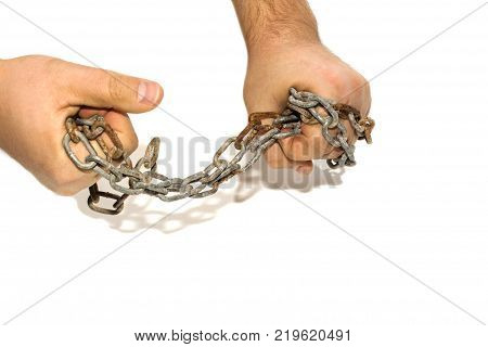 Hands in chains isolated on white background. Rusty old chain