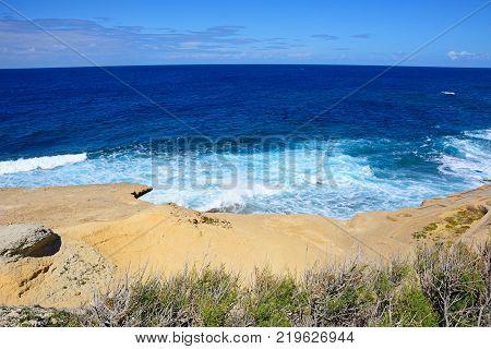 Panoramic view of the sea and rocky coastline Redoubt Marsalforn Gozo Malta Europe.