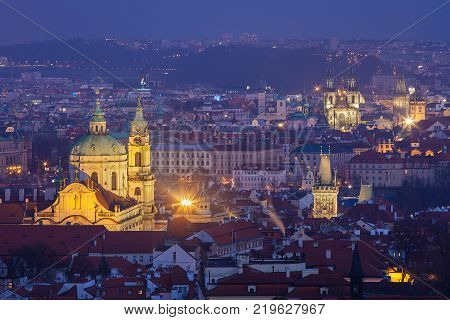 Cityscape of Prague, Czech Republic. Beautiful baroque St. Nicolas Church in winter evening. UNESCO World Heritage Site.