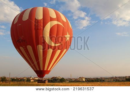 Goreme Cappadocia Turkey - August 16 2017: The great tourist attraction of Cappadocia - balloon flight. Cappadocia is known around the world as one of the best places to fly with hot air balloons.