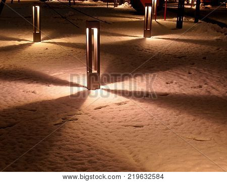 Light, shadow and shape. Lodz, Poland - December 21, 2017 A phenomenal play of shadow and shape on snow in the patio of one of Lodz's shopping centers.