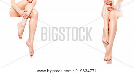 Two beautiful slender womans with red manicure, sitting at banner, isolated on white background