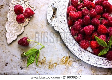 Raspberries With Spoon. A Fresh Raspberry On A Silver Plate. Ripe Fresh Raspberries With Leaves On R