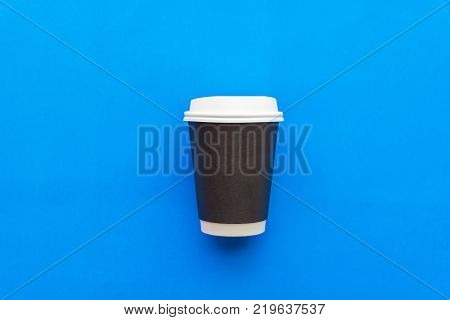 Coffee cup.Hot Coffee Cup Blue Background.Morning hot coffee in cup on blue background,copy space,Top view,flat lay,minimal style