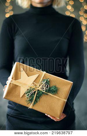 Girl holds a Christmas present. Christmas concept