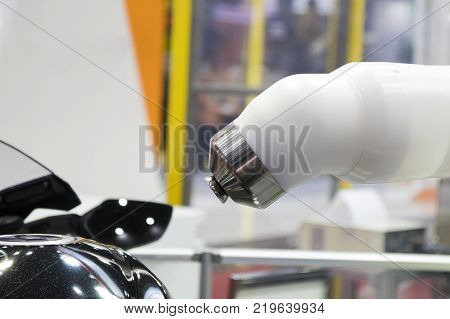 Spray painting robot and body part ; close up