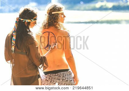 Beautiful Free Hippie Girls. Body Painting. Peace And Love - Vintage Effect Photo