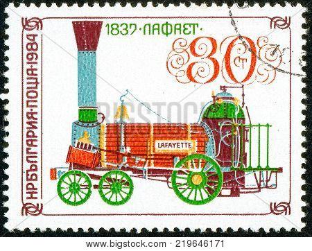 Ukraine - circa 2017: A postage stamp printed in Bulgaria shows drawing Locomotive Lafayette 1837. Series: Old steam locomotives. Circa 1984.