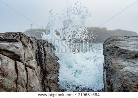 Waves Burst on Rocks on Maine's coast near Neddick Lighthouse