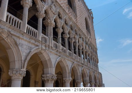 Part of the facade of Doge's Palace (Palazzo Ducale) in Venice during the day show the detailed gothic style architecture