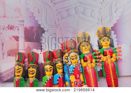 Wood made Goddess Durga handicrafts on display during the Handicraft Fair in Kolkata - the biggest handicrafts fair in Asia.