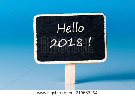 Hello 2018 - New Year coming concept. Happy New Year 2018 replace 2017 concept isolated on blue background