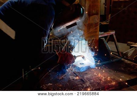 Welder In Workshop Conditions Sample Weld From Sheet Metal To Undergo Certification