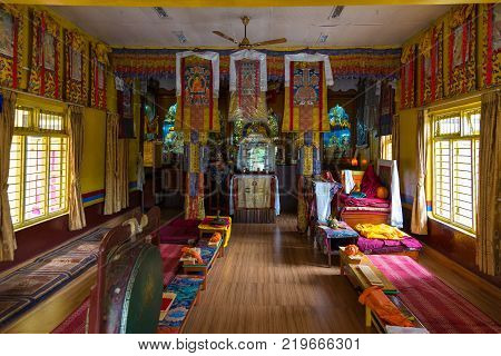 POKHARA NEPAL - September 30 2013: Interior of the temple in Tashi Ling village. Tashi Ling is one of the Tibetan refugee camps in Nepal