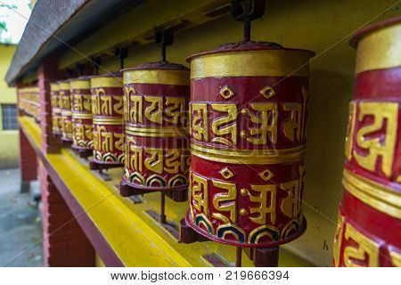 Tibetan prayer mills in the temple in Tashi Ling village. Tashi Ling is one of the Tibetan refugee camps in Nepal