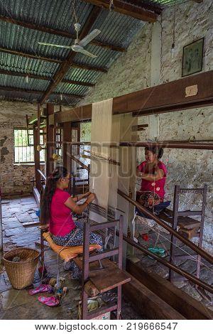 POKHARA NEPAL - September 30 2013: Tibetan women are working in Tashi Ling village. Tashi Ling is one of the Tibetan refugee camps in Nepal