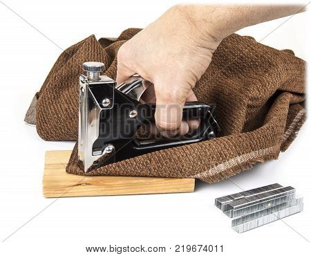Heavy duty staple gun with staples on the white background