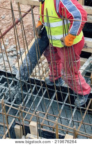 Pouring Concrete Footing From Cement Mixer
