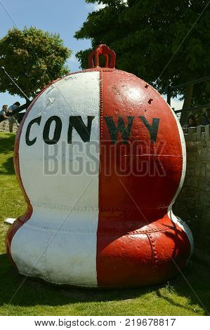 Conwy Wales United Kingdom - June 22 2014 : Redundant navigation buoy re-cycled as a town marker in Conway North Wales